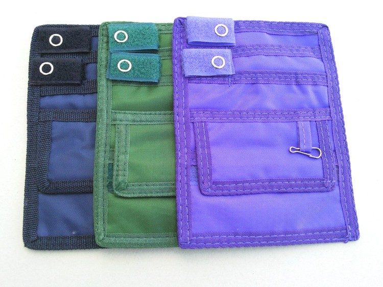 This deluxe nylon pocket organizer features five separate pockets and ...